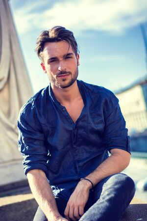 One handsome young man in urban setting in European city, Turin in Italy