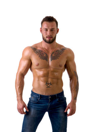 Muscular male bodybuilder standing and looking at camera, shirtless