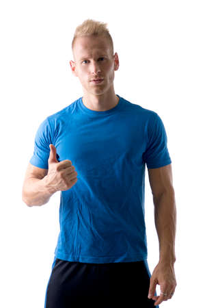 Attractive and muscular young man with thumb up doing OK sign, isolated on white