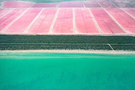 A bird's-eye view of the pink salt lakes separated by a sand spit from the Gulf of Mexico on the Yucatan in Mexico