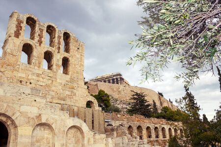 View of Odeon of Herodes Atticus with part of the Parthenon temple on the Athenian Acropolis in the background, Athens, Greece, December 19 2017.