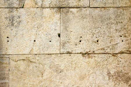 Ancient stone tiles wall vintage background 스톡 콘텐츠