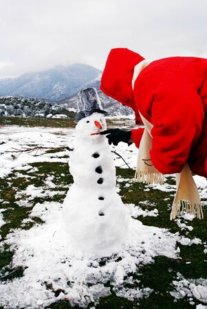 A snowman at the village Kryovrisi of Olympus mountain. Thessaly region, northern Greece.