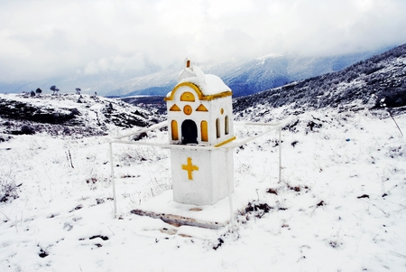 A church-like small-scale replica for candle-lighting on the way to the monastery of Holy Trinity at Kryovrisi village. Mountain Olympus, Thessaly region, northern Greece. Stock Photo