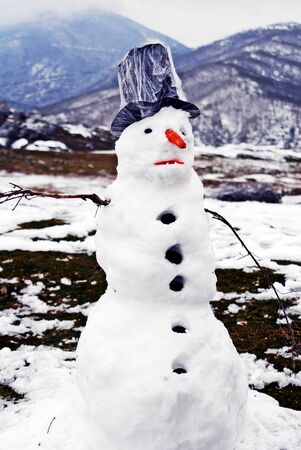 A snowman at the village Kryovrisi of mountain Olympus. Thessaly region, northern Greece. Stock Photo