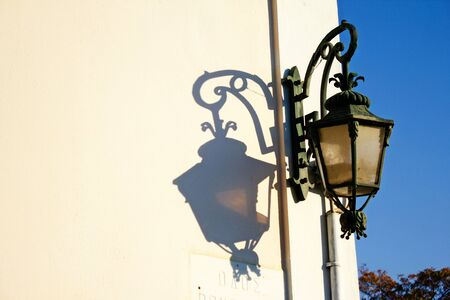 Decorative street light out of a neoclassical house, in the traditional neighborhood of Plaka in Athens, Greece.