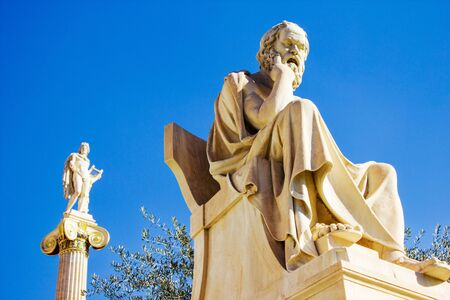Statues of the ancient Greek philosopher Socrates and God Apollo outside of the Academy of Athens in  Athens, Greece.
