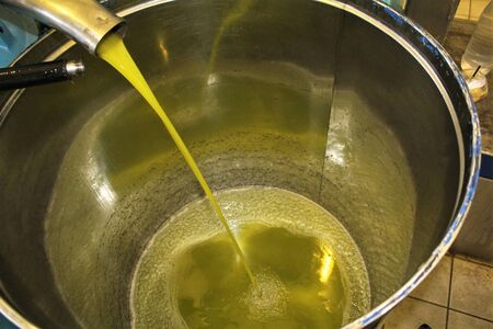 Extra virgin olive oil extraction process in olive oil mill in Greece.