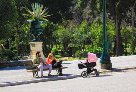 Greece, Athens, March 3 2020 - Couple with baby stroller at Zappeio.