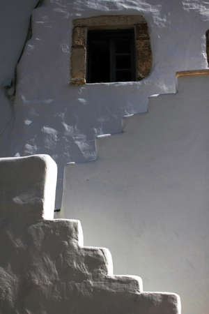 Greece, Antiparos island, detail from house with exterior stairway in the main town.