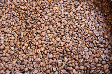 Raw coffee beans in sacks, coffee shop in Athens, Greece.