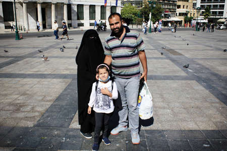 Portrait of a family of Muslim immigrants in the center of Athens, Greece, October 9 2020.