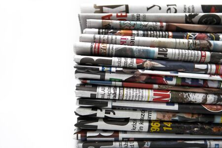 Pile of newspapers on the white background photo