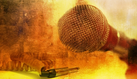 Grunge music background with vintage dynamic microphone photo