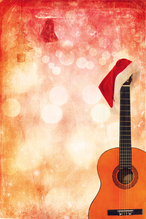 Christmas cap with Classic Guitar on grunge background photo