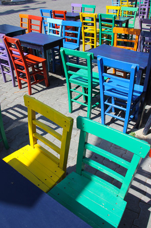 antique chair: Artistic colorful tables and chairs on the street in kas