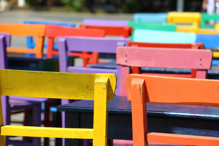 Artistic colorful tables and chairs on the street in kas photo
