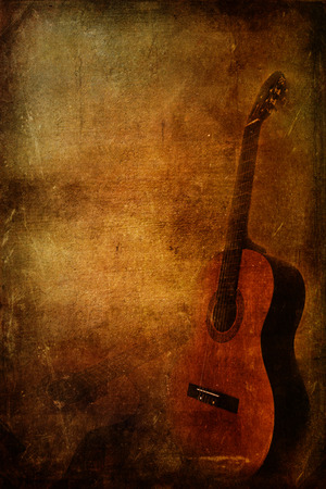 Musical vintage background with classic guitar instrument photo