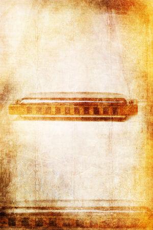Grunge music background with blues harmonica Stock Photo