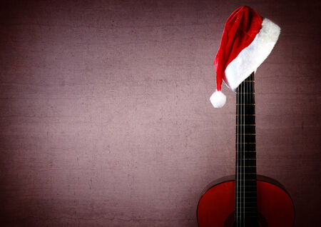 Red New Year Christmas Guitar with noel cap. photo