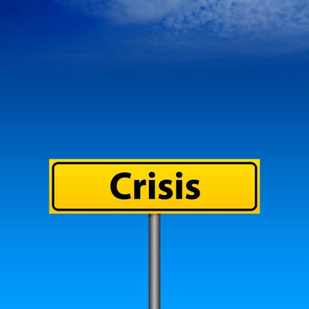 The yellow Crisis direction sign and blue sky background photo