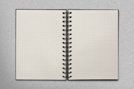school notebook: checked notepad on metal background Stock Photo