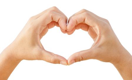 simbolo de la mujer: Manos femeninas en forma de corazón aislado en el fondo blanco Foto de archivo