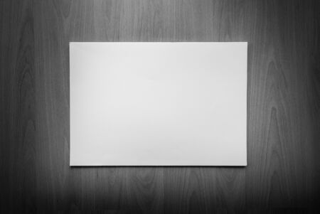 notebook paper background: White paper pulled out from a notebook on a wood background Stock Photo