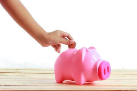 coin bank: Hand girl coin into piggy pig.