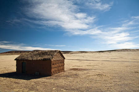 a house with a straw: isolated house in a bolivian desert Stock Photo