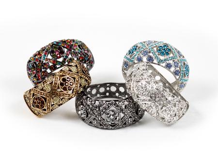 silver background: Beautiful bracelets isolated on white background