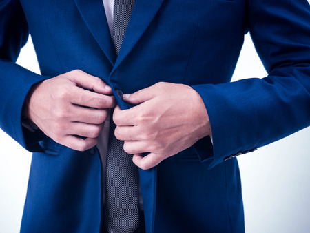 cuff link: Business Man fixing his suit