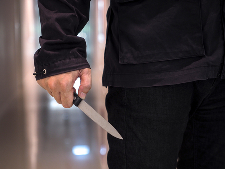Killer man is attacking with knife