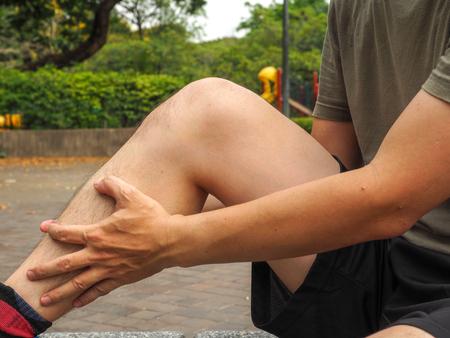 rupture: Running sport injury. male athlete jogger wearing man runner massaging calf muscle before workout. Stock Photo