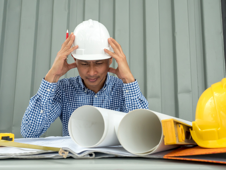 Have stress, Asia Engineer serious thinking, young man and looking away while sitting.