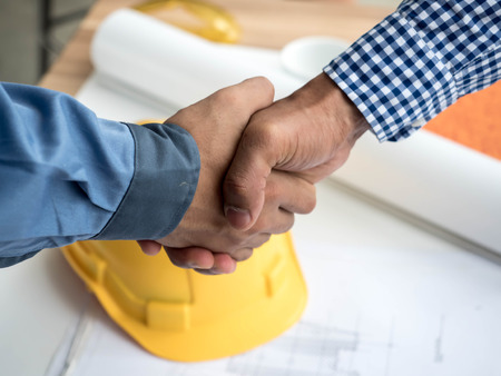 Close-up of business engineer planing at construction site project, documents, worker tool Reklamní fotografie - 84653198
