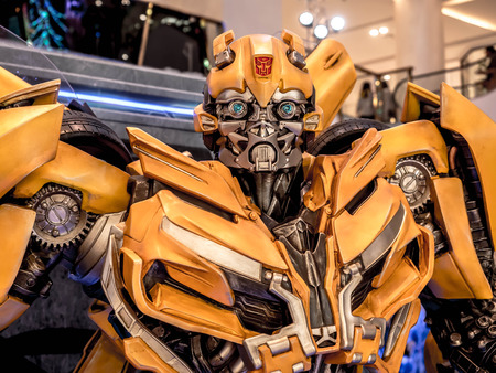 June 15, 2017: Bumblebee from Transformers: The Last Knight. It is the fifth installment of the live-action Transformers film series directed by Michael Bay at the emporium Bangkok Thailand. Banco de Imagens - 84694883