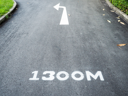Left turn arrow signals a marked run path 1,300 meters. Stock Photo