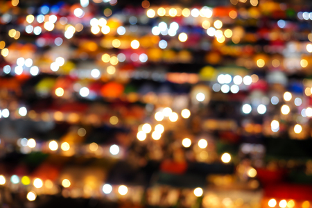 Abstract blur bokeh background of night market high view from building colorful tent retail shop and lighting at Rachada rain market Thailand Stock Photo