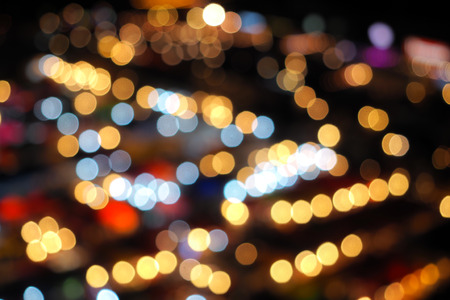 Blur bokeh background of multicolour lights of aerial view city night market Stock Photo