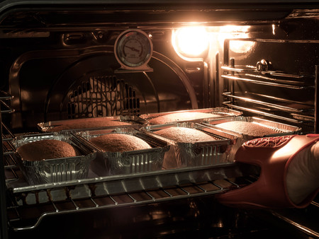 Production oven at the bakery. Baking bread. Manufacture of bread. Reklamní fotografie