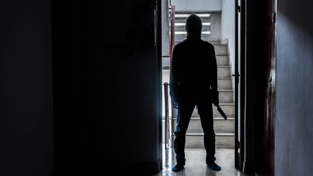 Silhouette of a man with knife in the apartment, Murder concept, Concept of disaster