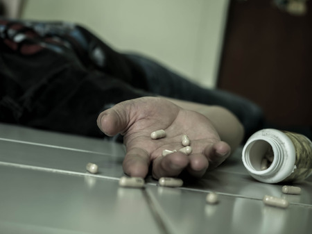 Close up of overdose pills. The man committing suicide by overdosing on medication, Drug addiction