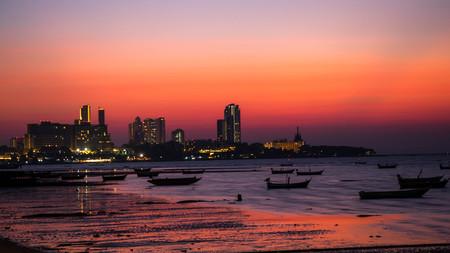 PATTAYA, THAILAND - January 14 - 2018: Fishing boats at coastal in sunset. The back of Pattaya city.