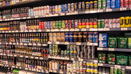 Bangkok, Thailand - January 14 - 2018: Shelf of beverage, domestic and imported beer cans and bottles at Super maket in Thailand.