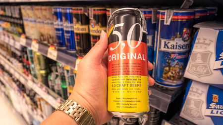 Bangkok, Thailand - January 14 - 2018 : The decision to buy Beer Cans at Super maket, Shelf of beverage, domestic and imported beer cans and bottles at Super maket.
