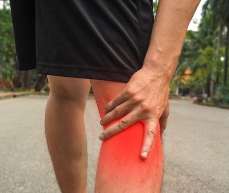 Sport men injury. male athlete jogger wearing man runner massaging calf muscle before workout. Stock Photo