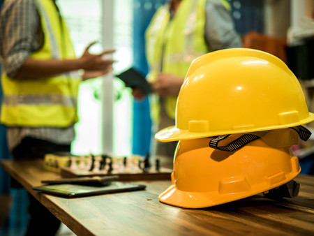 Yellow hard safety helmet hat for safety project of workman as engineer or worker, In the office, safety concept Foto de archivo - 100410349