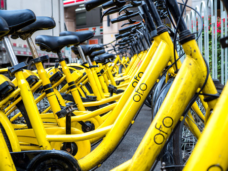 BEIJING, CHINA - MARCH 27, 2018: Ofo Bikes is the new bike sharing company in China. Ofo is a popular bike sharing platform where users grab bikes through an app in many cities in China.