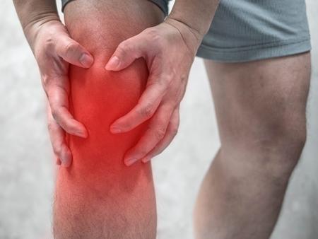 Man having pain in his knee, Health care Imagens
